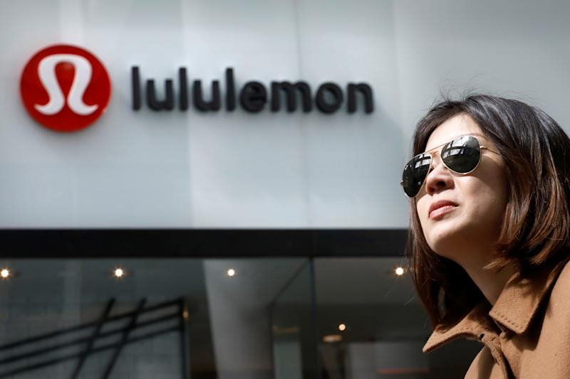 A woman passes by a Lululemon Athletica real store in New York City, U.S., March 30, 2017. REUTERS/Brendan McDermid