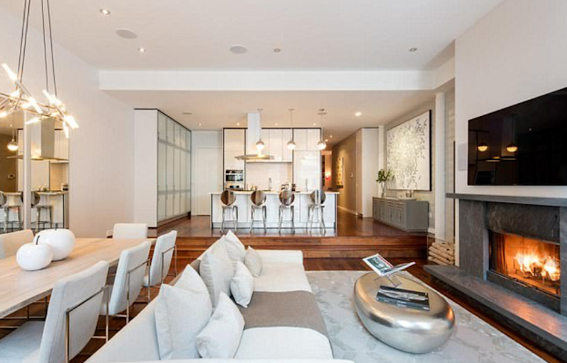 The 2,392 sqaure foot condo has two and a half bathrooms, fireplace and balcony. Source: Evan Joseph/Douglas Elliman
