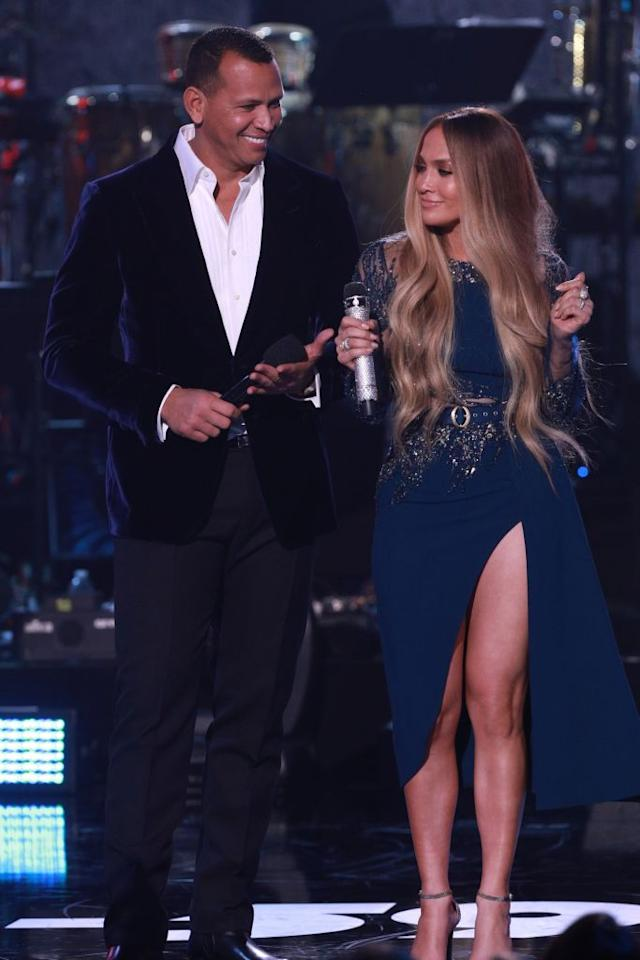 <p>The couple hosted One Voice: Somos Live! A Concert for Disaster Relief in early October, where they appeared onstage together in different shades of navy. A-Rod wore a dark velvet suit jacket, while J.Lo rocked a thigh-high slit dress. (Photo: Getty Images) </p>