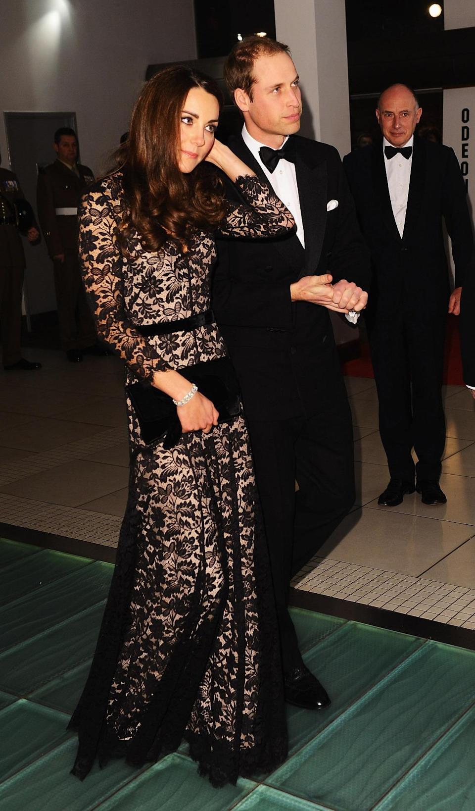 <p>Kate opted for a black lace dress by Temperley for the premiere of <i>War Horse</i>. She accessorised with a black velvet clutch by Mascaro.</p><p><i>[Photo: PA]</i></p>