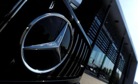 FILE PHOTO: A Mercedes Benz logo is pictured outside of Mercedes Benz branch in Stuttgart