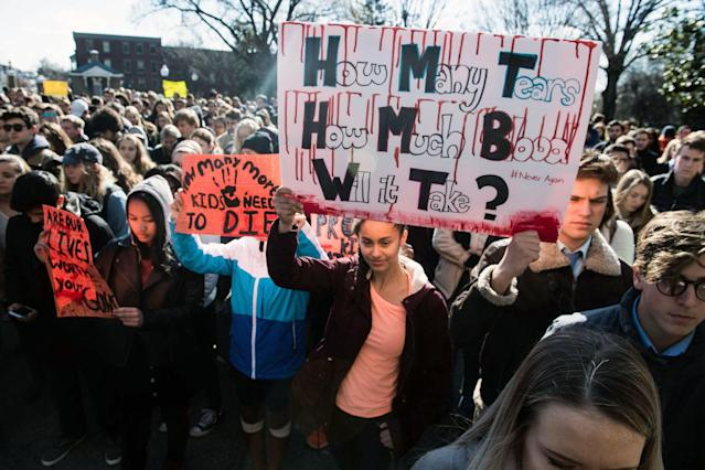 <p>Students hold signs at Georgetown University in Washington, D.C., on March 14, 2018, during a national walkout to protest gun violence. (Photo: Getty Images) </p>