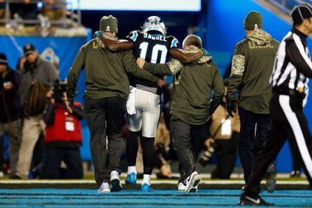 Nov 13, 2017; Charlotte, NC, USA; Carolina Panthers wide receiver Curtis Samuel (10) gets help off the field in the third quarter after an injury against the Miami Dolphins at Bank of America Stadium. Jeremy Brevard-USA TODAY Sports