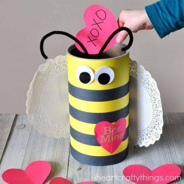 """<p>This little bee is buzzing to be yours! It's super easy to craft from recycled materials and a few art supplies. </p><p><strong>Get the tutorial at</strong> <a href=""""https://iheartcraftythings.com/bee-valentine-box.html"""" rel=""""nofollow noopener"""" target=""""_blank"""" data-ylk=""""slk:I Heart Crafty Things."""" class=""""link rapid-noclick-resp""""><strong>I Heart Crafty Things.</strong></a><br></p><p><a class=""""link rapid-noclick-resp"""" href=""""https://www.amazon.com/Tru-Ray-Construction-P103031-Standard-Assorted/dp/B00008XPH8/?tag=syn-yahoo-20&ascsubtag=%5Bartid%7C2164.g.35119968%5Bsrc%7Cyahoo-us"""" rel=""""nofollow noopener"""" target=""""_blank"""" data-ylk=""""slk:SHOP CONSTRUCTION PAPER"""">SHOP CONSTRUCTION PAPER</a></p>"""