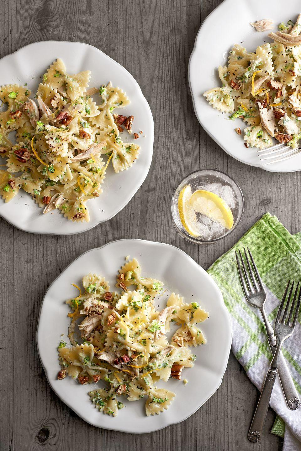 """<p>Toasted pecans add unexpected warmth and crunch to this creamy pasta dish.</p><p><strong><a href=""""https://www.countryliving.com/food-drinks/recipes/a6297/creamy-chicken-broccoli-pesto-bow-ties-recipe-clx0215/"""" rel=""""nofollow noopener"""" target=""""_blank"""" data-ylk=""""slk:Get the recipe"""" class=""""link rapid-noclick-resp"""">Get the recipe</a>.</strong></p>"""