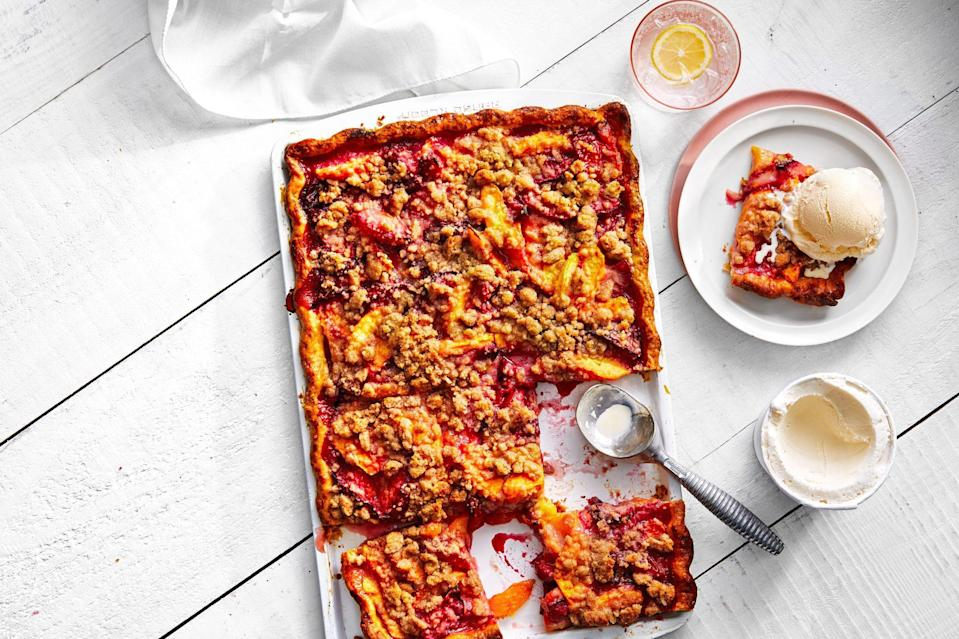 """<p><strong>Recipe: </strong><a href=""""https://www.southernliving.com/recipes/peach-plum-crumble-slab-pie"""" rel=""""nofollow noopener"""" target=""""_blank"""" data-ylk=""""slk:Peach-Plum Crumble Slab Pie"""" class=""""link rapid-noclick-resp""""><strong>Peach-Plum Crumble Slab Pie</strong></a></p> <p>Ripe peaches and plums pair with a simple mixture of sugar, cinnamon, butter, salt, and flour to create one mind-blowing crumble. The best part? We made it on a jelly roll pan fit for a crowd—the recipe makes a whopping 12 servings.</p>"""