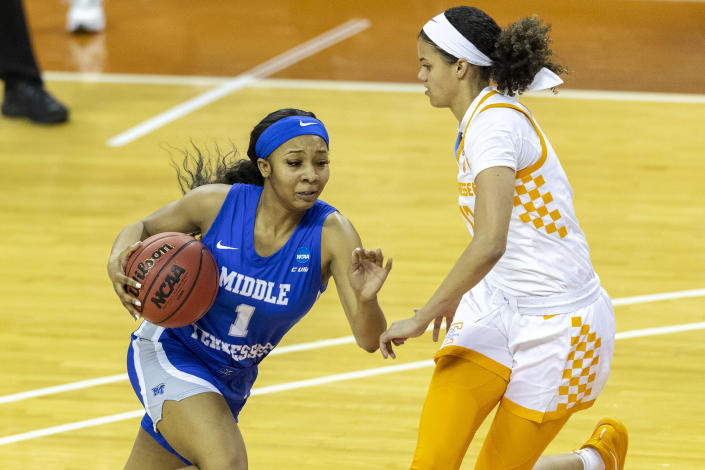 Middle Tennessee State guard Anastasia Hayes, left, drives around Tennessee guard Rae Burrell during the first half of a college basketball game in the first round of the women's NCAA basketball tournament at the Frank Erwin Center in Austin, Texas, Sunday, March 21, 2021. (AP Photo/Stephen Spillman)