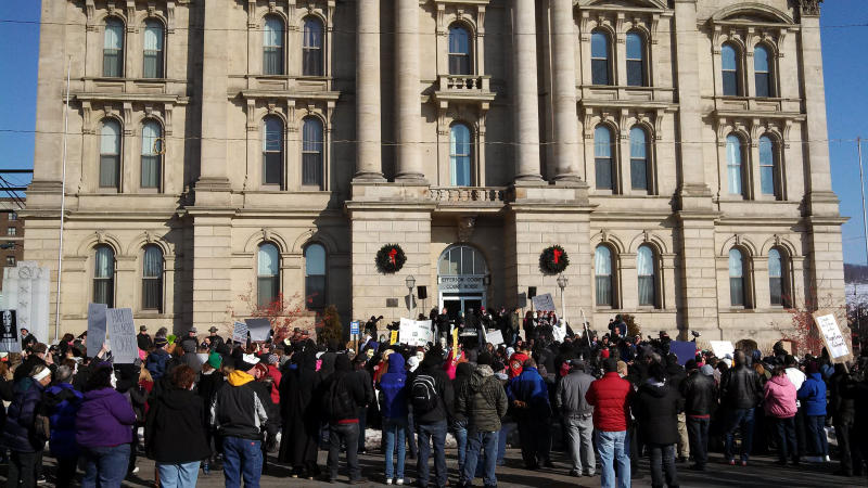 Protesters upset by the local sheriff's handling of a rape case involving two high school football players gathered in front of the Jefferson County courthouse in Steubenville, Ohio, on Jan. 5, 2013.