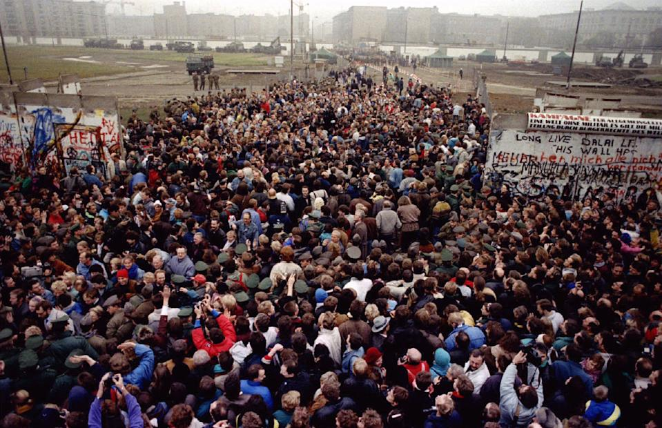 East Berliners cross and meet West Berliners at Potsdamer Platz after the Berlin Wall was torn down here making way for a new border crossing on Nov. 12, 1989. (Photo: Wolfgang Rattay/Reuters)