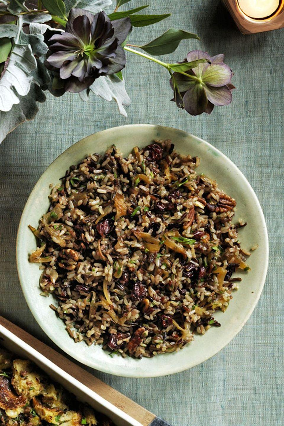 """<p>A hint of cinnamon adds unexpected sweetness to this flavorful side that can be made in advance and served at room temp!</p><p><em><a href=""""https://www.womansday.com/food-recipes/food-drinks/recipes/a60485/wild-rice-and-cherry-pilaf-recipe/"""" rel=""""nofollow noopener"""" target=""""_blank"""" data-ylk=""""slk:Get the recipe from Woman's Day »"""" class=""""link rapid-noclick-resp"""">Get the recipe from Woman's Day »</a></em></p>"""