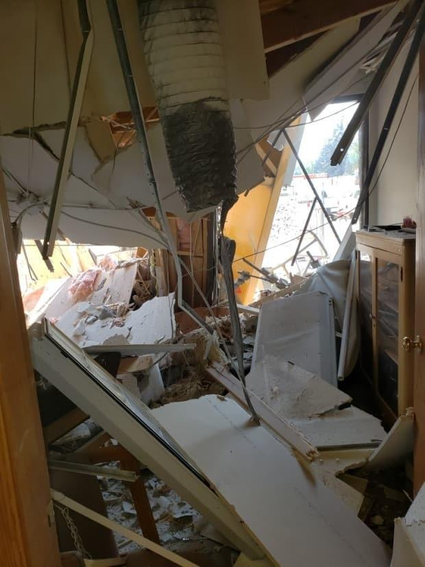 The ruined interior of an office is seen in Kelowna, B.C., on Monday. A crane that collapsed at a construction site next door smashed into the building's ground-floor, killing four people on the jobsite and one inside the adjacent building. (Kellie Orstead/The Canadian Press - image credit)