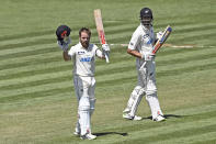 New Zealand's Kane Williamson celebrates his double century during play on day two of the first cricket test between the West Indies and New Zealand in Hamilton, New Zealand, Friday, Dec. 4, 2020. (Andrew Cornaga/Photosport via AP)