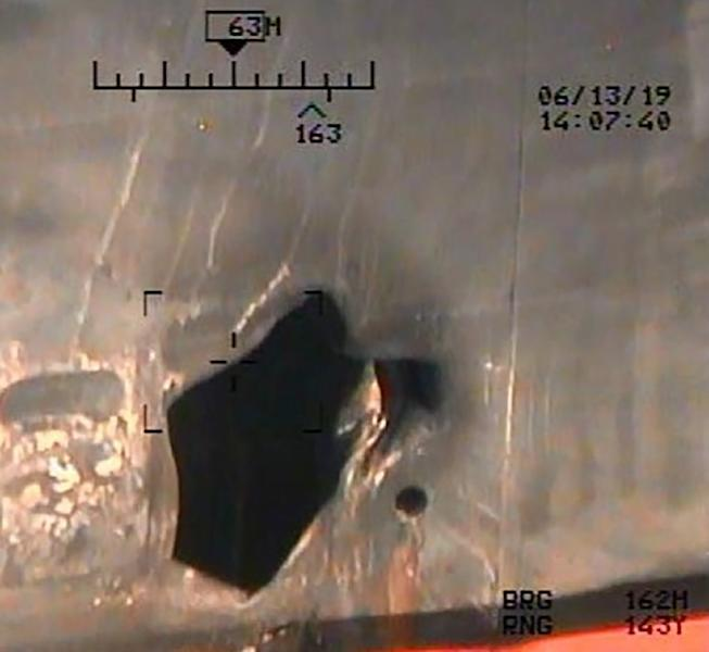 An image released by the US Department of Defense on July 17, 2019 shows damage from an alleged limpet mine attack on a tanker in the Gulf of Oman (AFP Photo/-)