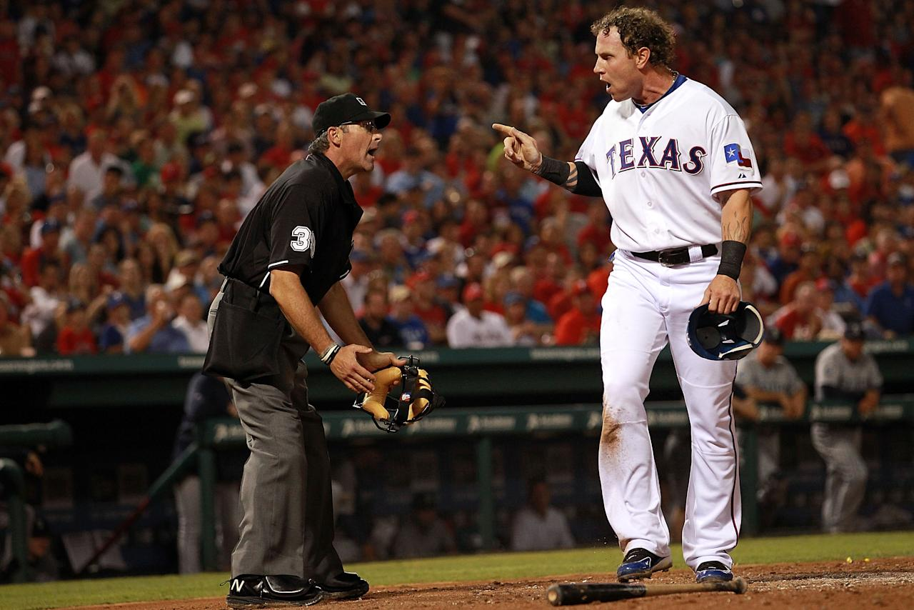 ARLINGTON, TX - APRIL 09:  Josh Hamilton #32 of the Texas Rangers argues an out call with Paul Nauert during play against the Seattle Mariners at Rangers Ballpark in Arlington on April 9, 2012 in Arlington, Texas.  (Photo by Ronald Martinez/Getty Images)