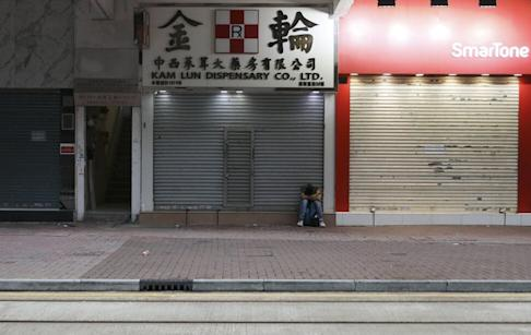 Many streets were empty after the early morning raising of the No 8 signal. Photo: Nora Tam