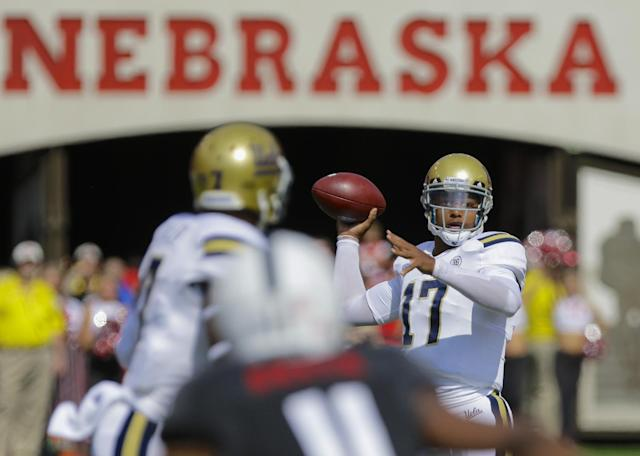 UCLA quarterback Brett Hundley (17) looks for a receiver in the first half of an NCAA college football game against Nebraska in Lincoln, Neb., Saturday, Sept. 14, 2013. (AP Photo/Nati Harnik)