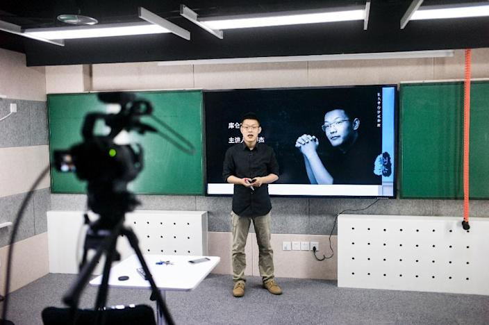 A Chinese high school physics tutor, Liu Jie belongs to a growing cohort of educators feeding the country's insatiable demand for after school online study (AFP Photo/Fred Dufour)