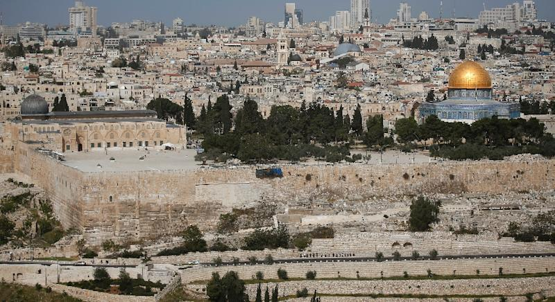 General view of the Dome of the Rock (R) and al-Aqsa mosque (L) both in the al-Aqsa morque compound seen in the Old City of Jerusalem on April 16, 2014