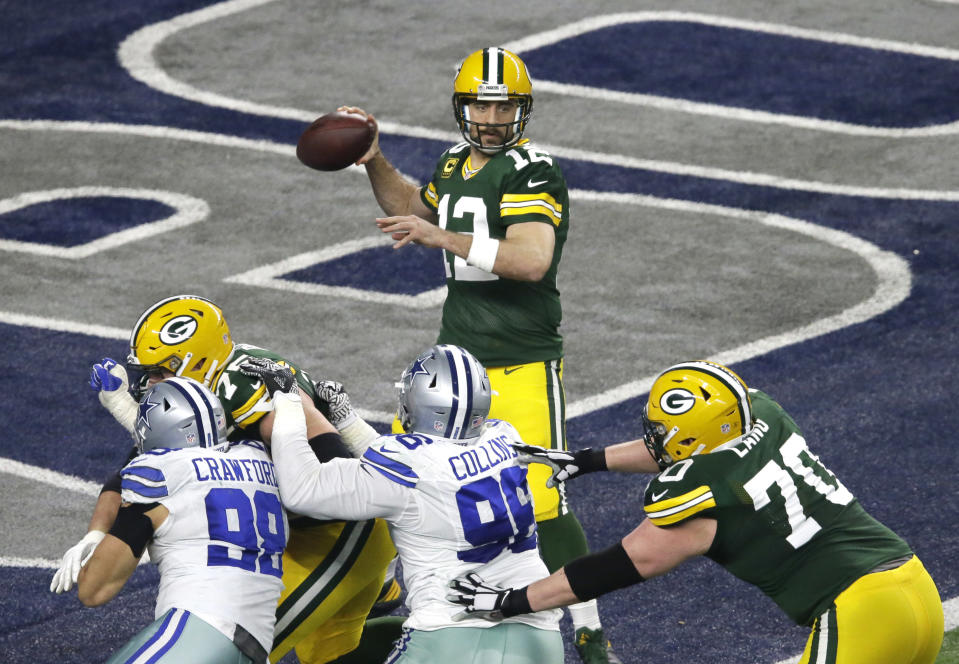 Green Bay Packers quarterback Aaron Rodgers throws a pass against the Dallas Cowboys during the first half of an NFL divisional playoff football game Sunday, Jan. 15, 2017, in Arlington, Texas. (AP Photo/Mat Otero)