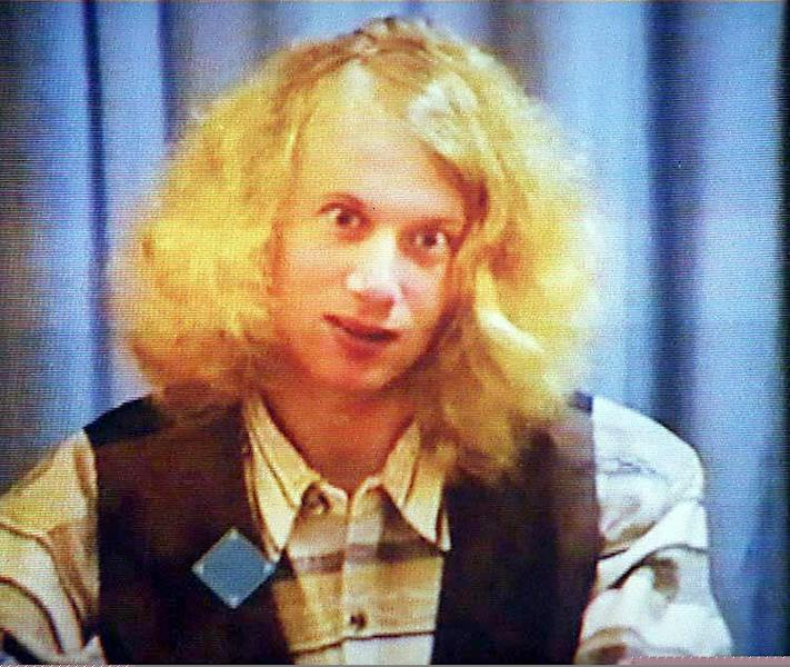 Martin Bryant, the gunman who massacred 35 people during a shooting rampage at Port Arthur, appears on screen during his first court hearing on May 22, 1996 (AFP Photo/)