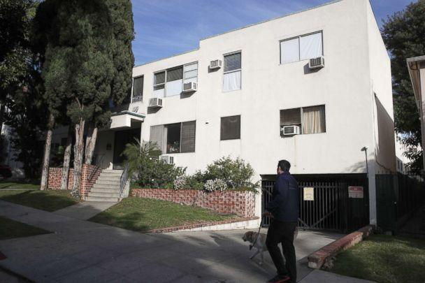 PHOTO: A man walks his dog past an apartment building, Jan. 8, 2019, where a man died in the apartment of Democratic Party donor Ed Buck, in West Hollywood, Calif. (Jae C. Hong/AP, FILE)