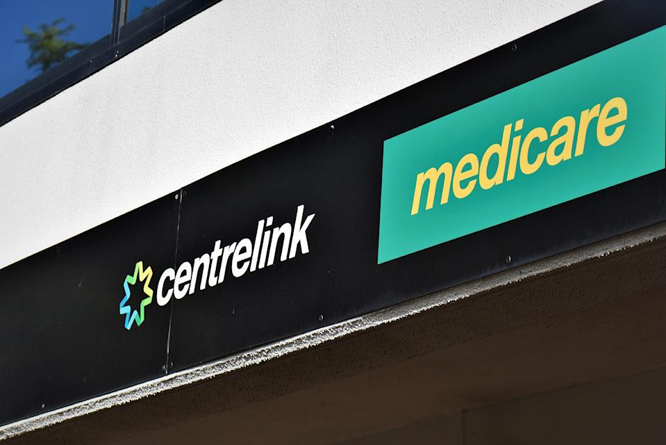 A Medicare and Centrelink ( Social security payments) office sign is seen at Ryde, Syndey on March 12, 2020 in Sydney, Australia. Government will inject a multi-billion dollar coronavirus stimulus package into the economy, with funding for small businesses, pensioners and the aged care sector among its largest elements. The stimulus package is crucial to supporting Australians, the business community and the economy in this time of crisis. (Photo by Izhar Khan/NurPhoto via Getty Images)