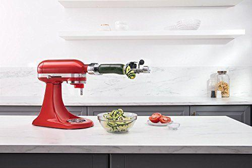 "<p><strong>KitchenAid</strong></p><p>amazon.com</p><p><strong>$89.99</strong></p><p><a href=""https://www.amazon.com/dp/B01FFRR7NK?tag=syn-yahoo-20&ascsubtag=%5Bartid%7C10055.g.34922659%5Bsrc%7Cyahoo-us"" rel=""nofollow noopener"" target=""_blank"" data-ylk=""slk:Shop Now"" class=""link rapid-noclick-resp"">Shop Now</a></p><p>If you keep a KitchenAid stand mixer within reach, this makes a great vegetable peeler. <strong>The attachment plugs into the power hub on the front of the mixer and makes peeling a variety of vegetables as easy as flipping a knob. </strong>You slide your produce onto the attachment's skewer mount and then insert the peeler blade and align it with the food. It peels your potato, zucchini, cucumber, and more quickly and with little waste. This attachment is handy if you are prepping, say, a whole pie's worth of apples, and it's also helpful for those who have trouble using standard peelers. It works with produce up to 5½ inches in length, so long veggies will need to be trimmed. Bonus: It can also be used as a corer, slicer and spiralizer, so there's a little extra incentive to leave it set up.<br></p>"