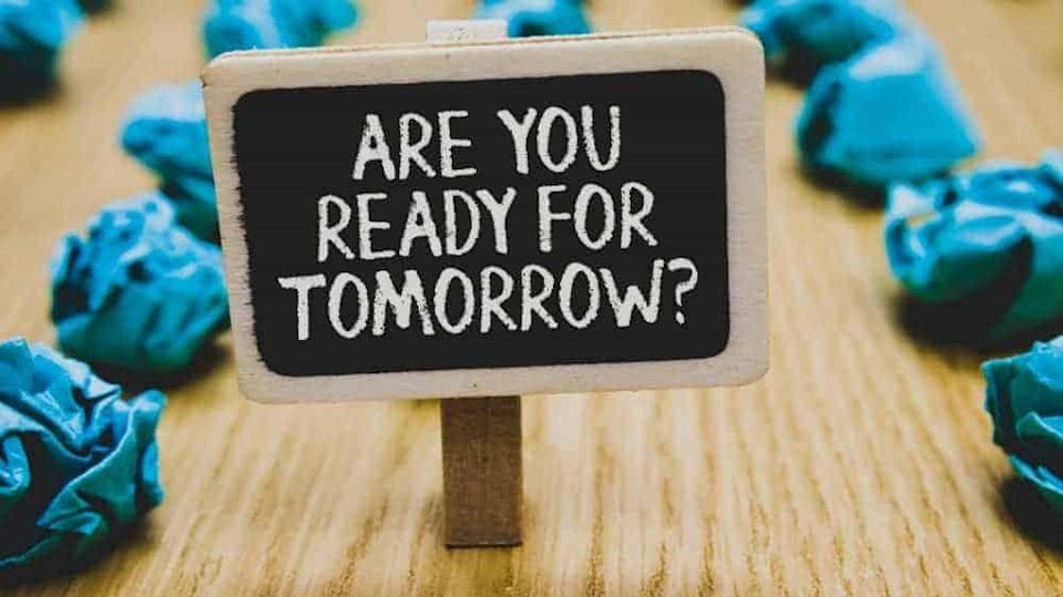 Handwriting text writing Are You Ready For Tomorrow question. Concept meaning Preparation to the future Motivation Stand blackboard with white words behind blurry blue paper lobs woody floor.