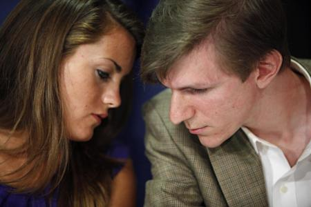 This October 2009 file photo shows Hannah Giles, left, talking with James O'Keefe III during a news conference at the National Press Club in Washington. The conservative activist whose hidden camera videos led to the downfall of the community group ACORN has settled a lawsuit with a former ACORN employee who appeared in them. In documents filed in a San Diego court, James O'Keefe agreed to pay Juan Carlos Vera $100,000 and apologized for any pain Vera suffered. (AP Photo/Haraz N. Ghanbari, file)