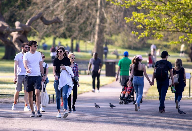 LONDON, ENGLAND - APRIL 10: Groups of People walking in Regents Park, Good Friday on April 10, 2020 in London. There have been around 70,000 reported cases of the COVID-19 coronavirus in the United Kingdom and 8,000 deaths. The country is in its third week of lockdown measures aimed at slowing the spread of the virus. (Photo by Jo Hale/Getty Images)