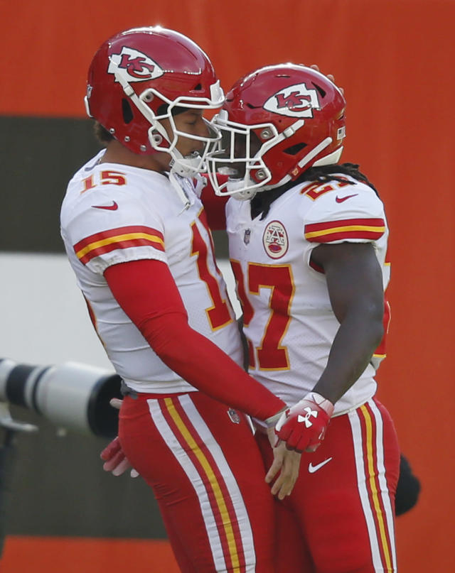 Kansas City Chiefs running back Kareem Hunt (27) celebrates with quarterback Patrick Mahomes (15) after a 50-yard touchdown during the first half of an NFL football game against the Cleveland Browns, Sunday, Nov. 4, 2018, in Cleveland. (AP Photo/Ron Schwane)