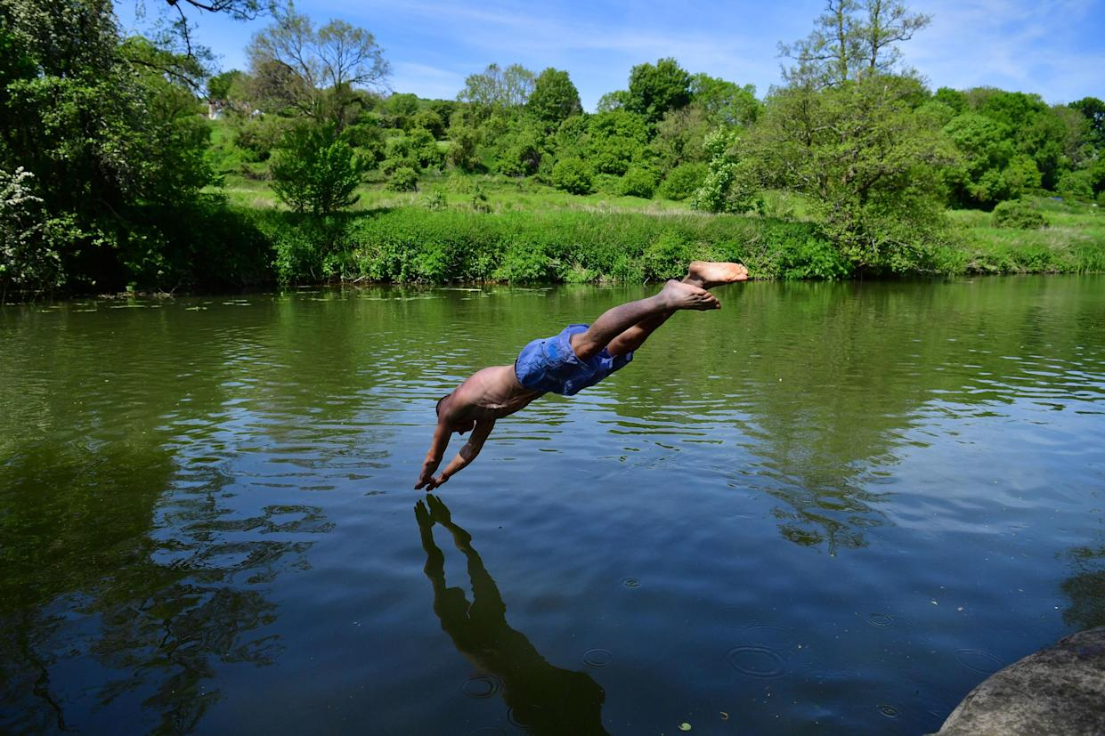 Swimmers enjoy the hot weather