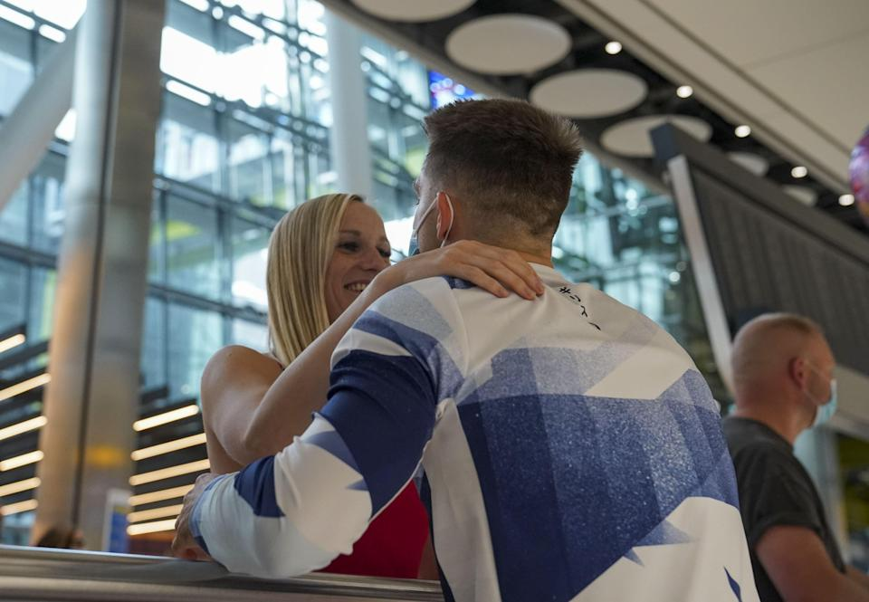 Max Whitlock hugs his wife Leah (Steve Parsons/PA) (PA Wire)