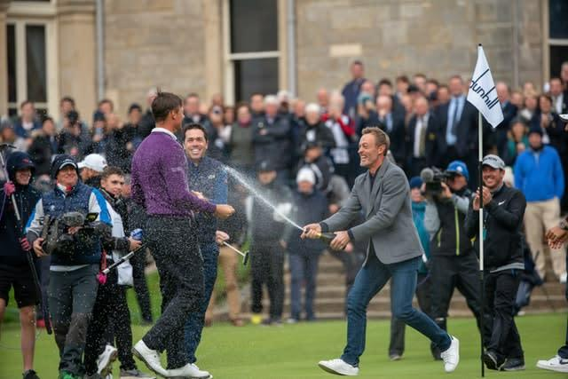 Victor Perez is congratulated by his French colleagues, led by Raphael Jacquelin, after winning the Alfred Dunhill Links Championship (Kenny Smith/PA)