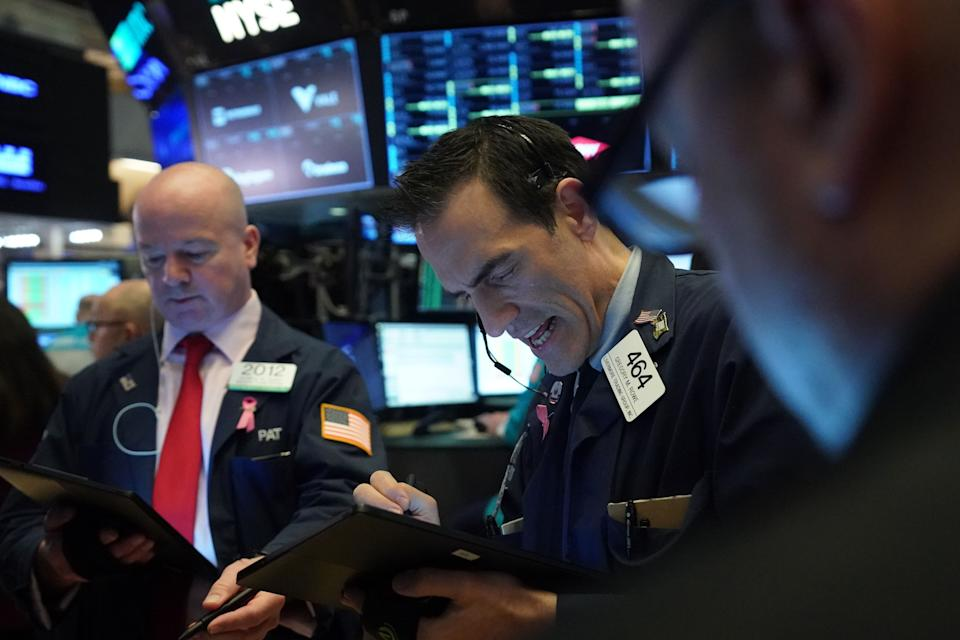 Traders work on the floor at the opening bell of the Dow Industrial Average at the New York Stock Exchange on March 12, 2020 in New York. - Wall Street stocks were deep in the red early Thursday, resuming after a 15-minute suspension as the economic pain from the coronavirus deepens and widens. About 25 minutes into trading, the Dow Jones Industrial Average was at 21,505.07, down more than 2,000 points or 8.7 percent. (Photo by Bryan R. Smith / AFP) (Photo by BRYAN R. SMITH/AFP via Getty Images)