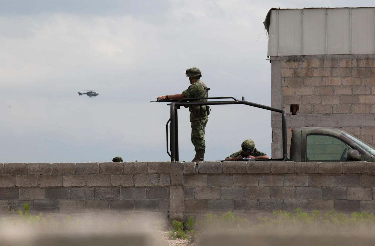 Soldiers guard a half-built house near the Altiplano maximum security prison in Almoloya, west of Mexico City, Sunday, July 12, 2015. (AP Photo/Marco Ugarte)