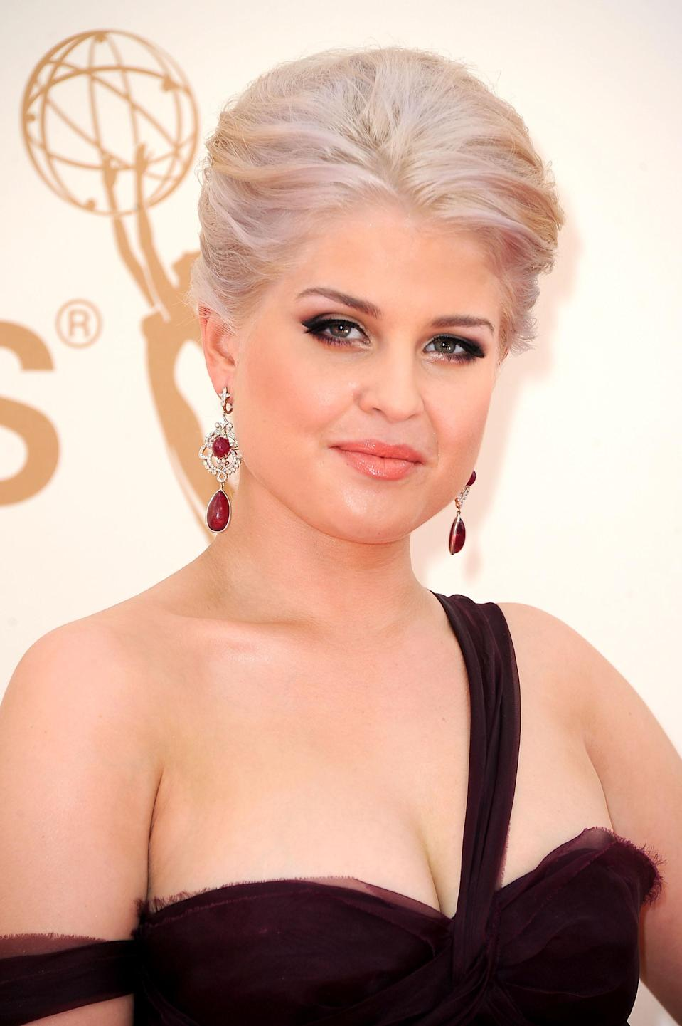 <p>Kelly Osbourne's classy updo gives her rendition of silver hair an enchanting glow. (Photo: Getty Images) </p>