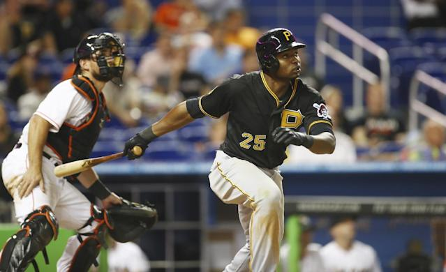 Miami Marlins catcher Jeff Mathis watches as Pittsburgh Pirates batter Gregory Polanco (25) hits a two-run home run during the 13th inning of a baseball game in Miami, Friday, June 13, 2014. The Pirates won 8-6 in the 13th inning.(AP Photo/J Pat Carter)
