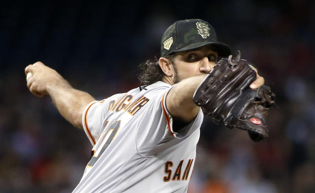 San Francisco Giants starting pitcher Madison Bumgarner throws to an Arizona Diamondbacks batter during the first inning of a baseball game Saturday, May 18, 2019, in Phoenix. (AP Photo/Ralph Freso)