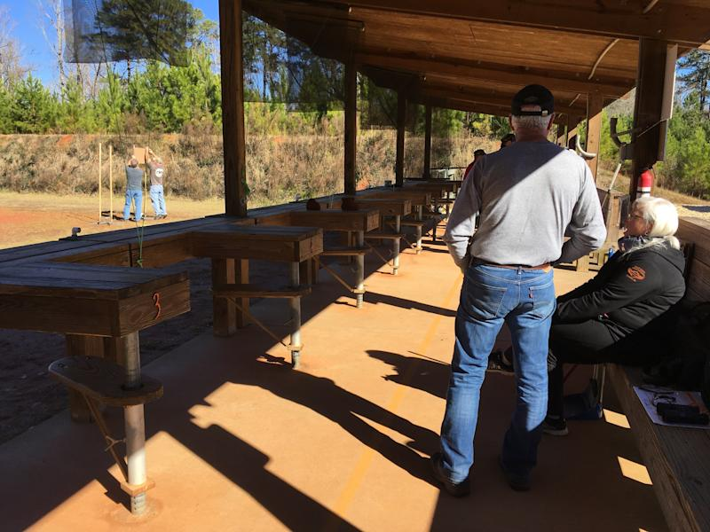 Some fellow shooters wait around while others set up their targets during a cease-fire at Cedar Creek, in January 2019. (Courtesy of Mel Plaut)