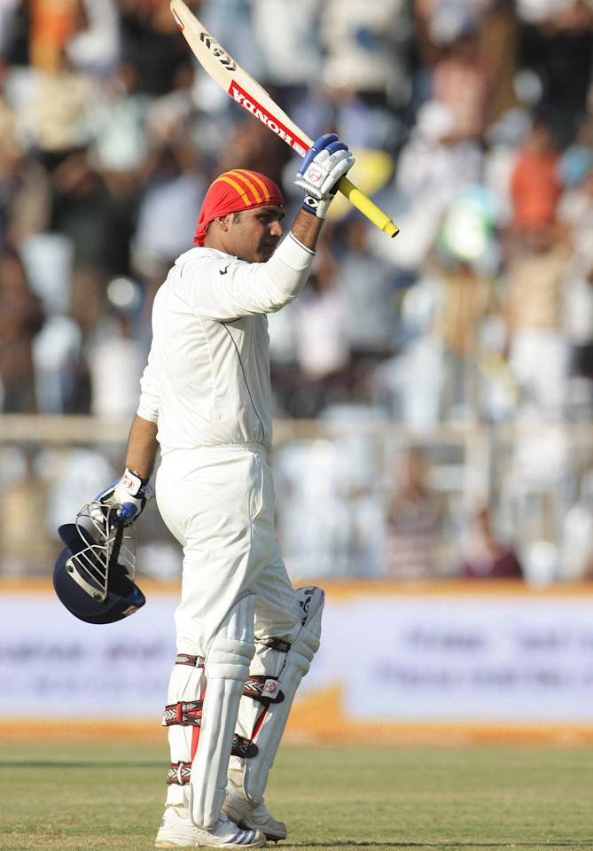 CHENNAI, INDIA - MARCH 28:  Virender Sehwag celebrates his 300 runs during day 3 of the 1st test match between India and South Africa held at MA Chidambaram Stadium on March 28, 2008 in Chennai, India. (Photo by Duif du Toit/Gallo Images/Getty Images)