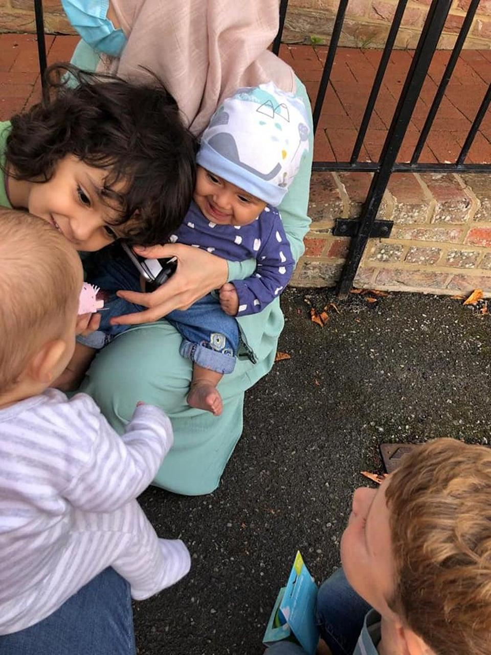 Madiha (wearing a hat), with her brother, Wais, 2, looking at Barney. Archer, 6, Barney's brother is on the far right of the photo (Matt Simmons/PA).