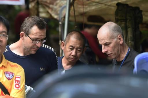 Volanthen (L) and Stanton (R) pictured with Thai personnel at the Tham Luang cave during the rescue