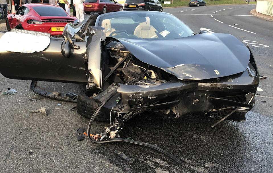 The grey Ferrari 458 following the collision in Sheffield (Picture: SWNS)