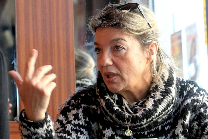 In this Dec. 11, 2012, photo, Carolina Quastana, who ran a business in Corsica, worked as a commercial judge and is the daughter of one of the nationalist movement's founders, answers the Associated Press in Ajaccio, Corsica, France. Quastana fears Corsica is pulling itself apart, and that the attacks against the homes are essentially no different than the gangland killings. Of the 85 gangland killings and attempted assassinations in Corsica in the past eight years, only one case _ a plot against a former nationalist turned president of the local soccer club _ has ended in conviction. (AP Photo/Jean-Pierre Belzit)