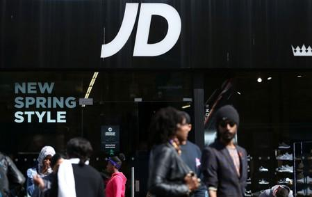 FILE PHOTO: People pass a JD Sports store in London