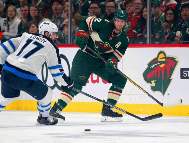 "Minnesota Wild center Eric Staal (12) passes past <a class=""link rapid-noclick-resp"" href=""/nhl/teams/wpg"" data-ylk=""slk:Winnipeg Jets"">Winnipeg Jets</a> center Adam Lowry (17) in the first period of Game 3 of an NHL first-round hockey playoff series Sunday, April 15, 2018, in St. Paul, Minn. (AP Photo/Andy Clayton-King)"