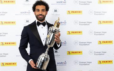 """Mohamed Salah's extraordinary debut season at Liverpool has been recognised with the Professional Footballers' Association Player of the Year award. Salah received the accolade from his peers ahead of Manchester City's Kevin De Bruyne, a fitting reward for a campaign in which he has matched the feats of Liverpool's goalscoring legends. The Egyptian is the first Liverpool player since Ian Rush to score 40 goals in a season, and has also matched Luis Suarez's record of 31 Premier League goals in a campaign. He may yet break Rush's goal record of 47 in a season. He currently has 41 goals in just 46 appearance in all competitions. Mohamed Salah shows off his trophy after being named PFA Player of the Year on Sunday night Credit: PA """"It's a big honour. I've worked hard and I'm very happy to win it,"""" Salah said at the ceremony on Sunday night. Asked what it meant to become the first Egyptian to win the award, he said: """"Hopefully, I'm not the last one. I'm very proud to win."""" Since his £39 million move from Roma, Salah has been a major influence in Jurgen Klopp's side reaching the semi-finals of the Champions League, terrorising Premier League and European defences with his pace and exquisite finishing. Not only did he fend off the challenge of De Bruyne, but also fellow shortlisted nominees David Silva, David de Gea and Harry Kane. Salah is outscoring Messi and is on course to re-write the Premier League record books Salah said his ambitions for this season were far from over. """"To break the Premier League record is something huge in England and all over in the world,"""" he said. """"There are still three games to go. I want to break this record and also break the one for a 42-game season."""" Salah attended yesterday's award ceremony with Liverpool captain Jordan Henderson, a request the Egyptian made as he wanted to share the honour with his team-mates. Manager Klopp did not attend because he is preparing for tomorrow's Champions League semi-final first leg with Salah's former c"""