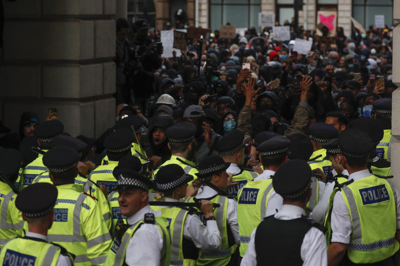British police and protesters during the Black Lives Matter protest rally in London, Sunday, June 7, 2020. George Floyd rallies have been held around the world.