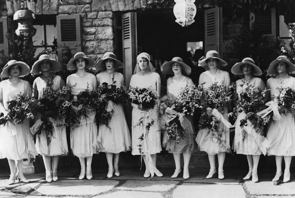 <p>Although '20s bridal style veered towards the modern silhouette (a.k.a. the drop waist dress), many brides still opted for tradition and dressed their bridesmaids in all white. </p>